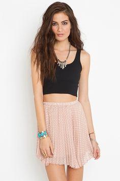 LOVE the high waist skirt/ crop top combo.