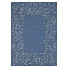 """Bring timeless elegance to your dining room ensemble or den seating group with this artfully loomed rug, showcasing a scrolling botanical-inspired border motif in blue and ivory.   Product: RugConstruction Material: PolypropyleneColor: Blue and ivoryFeatures:  Power-loomedScrolling botanical-inspired border motifSuitable for indoor and outdoor use Made in BelgiumPile Height: 0.25""""Note: Please be aware that actual colors may vary from those shown on your screen. Accent rugs may also not show…"""