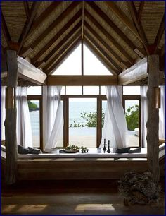 If you have a beach house, why not try putting your dining table next to a window through which one can see the ocean?