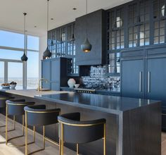 Love this blue kitchen, such a rich tone.