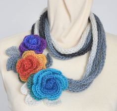 Multicolor Rose and Leaf scarf/lariat by jennysunny on Etsy. I don't like the colors, personally, but it's a nice pattern.