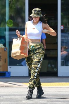 27fcdd67b4 Kylie Jenner decked in Camo - sporting Bape Camo sweatpants and a Camo  Boonie!