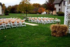vintage wedding, barn wedding, white wedding chairs, garden arbor, hay bales, burlap, baby's breath buckets