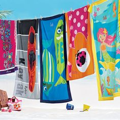 Beach towels for girls and boys in a choice of 6 exclusive designs: Fish Tail, Kayak, Floral, Lady Bug Dot, and Mermaid Friends. | Company Kids