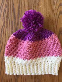 This is the hat that matches the Green Pom Pom Scarf that I published earlier this year. I LOVE the texture of this hat. Before you attach the pom pom, you can choose which side of the hat you want to use (it is completely reversible at this stage).