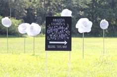 """""""Happily Ever After Begins This Way,"""" direction sign for wedding, 18"""" x 24"""" canvas, custom hand-drawn lettering chalkboard art inspired. $82 by Moulage Collection. Customize the design, the words, and the colors to fit your wedding. I screwed the stretched canvas into stakes, then hammered it into the ground."""