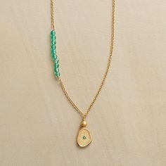 EMERALD ECHO NECKLACE--A procession of green onyx beads echoes the deeper hue of an emerald embedded in Anne Sportun's pendant. Handmade of 14kt gold