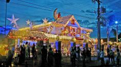 Curitiba residents line up to visit a house decorated with thousands of color light bulbs and Christmas symbols, December 16, 2003, in Curitiba, southern Brazil. (Getty Images, file)