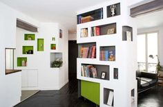 Apartment design by h2o architectes. The design uses the idea of bright color with a white blend. Divider made of shelves that are designed so perfectly. The layout is balanced, so that residents can move in this 60 sq.m space.