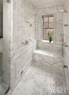 Walk in shower with bench and shelves by queen