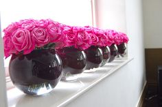 pink flowers/black vases