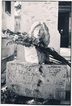 Jim Morrisons Grave    Pere Lachaise Cemetery, Paris 1981. The bust made by Croatian sculptor Mladen Mikulin was stolen in 1988 and has not been replaced. The gravesite has now been cleaned up and a guard has been posted.    There's an interesting website about Jim's grave here: jimmorrisonsparis.com/jim-morrisons-grave/