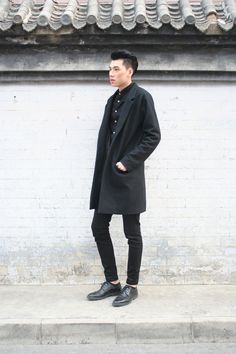 Layered head-to-toe black looks effortlessly put together on the street at China Fashion Week.WGSN street shot, Beijing