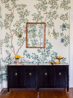 light + airy wallpaper is the perfect complement to a black lacquer armoire