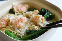 Chinese wonton noodles with dumplings and veggies.