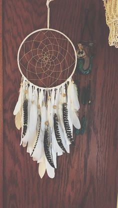 This gorgeous dreamcatcher is version of my popular white bohemian dreamcatcher. This one I added turkey feathers for accent. Please note there is a