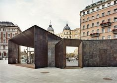 Stockholm Ferry Terminal Outfitted With A Patchwork Brass Square Facade by Marge Arkitekter