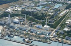 An aerial view shows the Tokyo Electric Power Co.'s (TEPCO) tsunami-crippled Fukushima Daiichi nuclear power plant and its contaminated wate...