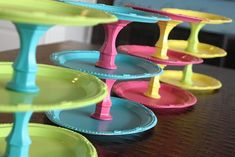 Colorful Tiered stand-  decorative plates and upside down clear glass candle sticks spray painted and glued to the plates
