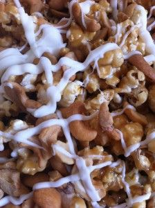 White Chocolate Cashew Caramel Popcorn - This is to die for!!  I used 4 bags popped popcorn and also sprinkled kosher salt on top after it was all combined together and laying on cookie sheet