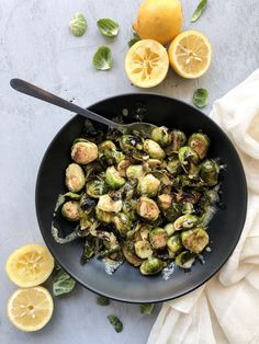 Roasted with lemon garlic ghee and a citrus sauce, these lemon dijon brussels sprouts are the perfect appetizer, snack or side dish. #lemongarlic #gheeroasted #brusselssprouts #crispybrusselssprouts