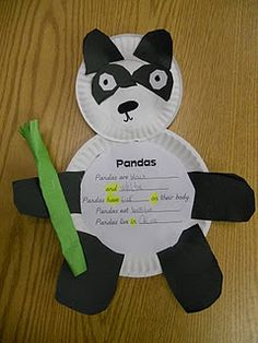 Pandas are_______  and ______  Pandas have ________ on their body  Pandas eat ________  Pandas live in __________