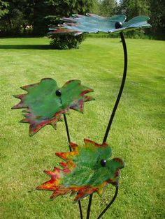 Glass & steel Floral, Fruit and Plantlife sculpture by artist Lynette Forrester titled: 'Autumn Leaves (kiln-formed art glass sculpture)' Glass Flowers, Ceramic Flowers, Glass Birds, Kiln Formed Glass, Sculptures Céramiques, Concrete Art, Welding Art, Fused Glass Art, Glass Garden