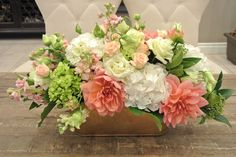 Rectangular table centerpiece with dahlias, hydrangea, lisianthus, spray roses, stocks, skimmia and roses. Designed by Forget-Me-Not Flowers, Banff.
