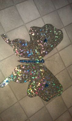 "This is my latest cut up cd mosaic..this time I have added some glass beads.It's 30"" wide and 30"" from top to bottom."