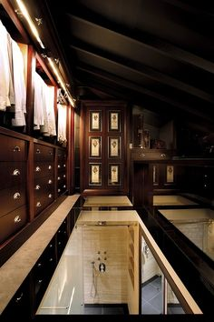 Gentleman's Dressing Room With Glass Floor With View of the Shower Below