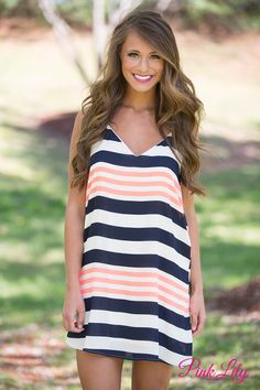 This dress is such a summer must-have! It features a bright and bold scheme, with navy, neon orange, and white stripes! With such a simple and classic style, you can't go wrong!