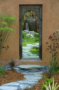Water bubbling out of the piece of slate would be nice. Also like the idea of a mirror in the garden