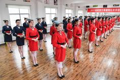 These photos portray the bizarre range of skills Chinese air hostesses require before they take to the skies