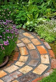 Chives edge a curving brick path - Pottering in North Cumbria sponsored by University of Cumbria Cumbrian Homes Ltd Copeland Borough Council - Silver Flora medal winner for Courtyard Garden at RHS Chelsea Flower Show 2009 Unique Gardens, Small Gardens, Beautiful Gardens, Outdoor Gardens, Brick Garden Edging, Brick Pathway, Walkway, Landscaping With Rocks, Backyard Landscaping