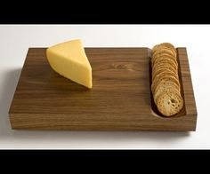 Design's signature wood, this dual purpose cheese and cutting board ...