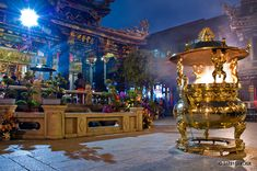 A golden incense pot in the inner courtyard of Longshan Temple in Taipei, Taiwan.