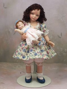 Terri Davis - porcelain little girl Cammie with dolly