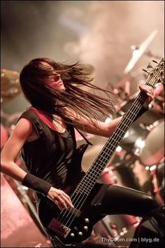 Elena (bassist for Alight). She kind of looks like her bass, long and thin. You can tell she's a tiny girl though. Rock on, sister.