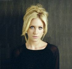 Brittany Snow. root lifter, two long half curled bangs, messy bun/french twisted up? piled on head.