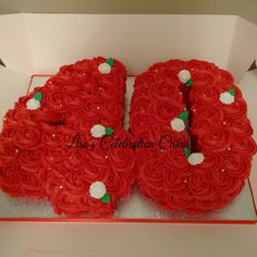40 vanilla number cake with red buttercream rose swirls and small white fondant roses.