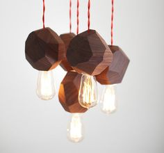 This beautiful geometric hanging light display iscrafted from solid walnut.  Designed & crafted by Dylan Grey