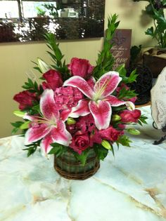 Stargazer lillies and pink intuition rose/lamar greenhouse and florist