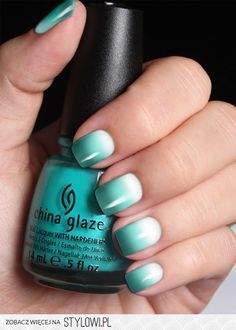 Ombre teal nails.