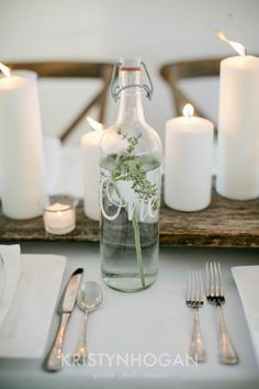 Bottles filed with herb infused water and hand lettered table numbers - UM yes please! #cedarwoodweddings Wood and White :: Cedarwood Style Inspiration | Cedarwood Weddings