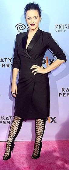 Ooh la la! The pop star looked sexy in a black tuxedo blazer dress with knee-high lace-up heels.