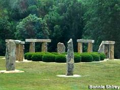 about halfway between louisville and nashville.  Munfordville, Kentucky -   Replica Stonehenge  Sort of like the crumbly one in England, but smaller and newer.    Address:  Lynn Ave., Munfordville, KY  Directions:  I-65 exit 65. Drive south on US Hwy 31W. Go through two sets of lights and then, after passing a small office complex, turn right onto Lynn Ave., a small street. You'll see the KY Stonehenge replica shortly.