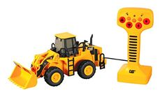 Control the forward and turn-in-reverse motion and machine lifting actions with a tethered remote control on this CAT Big Builders Wheel Loader Un. Caterpillar Toys, Play Vehicles, Motor Grader, Cat Toys, Tractors, Remote, Engineering, Construction, Trucks