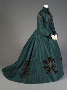 Emerald green silk taffeta dress trimmed with black velvet applique bows, American, 1860s,