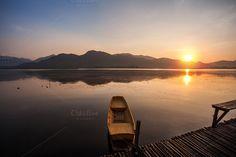 Serene lake with sunrise by Pushish Images on @creativemarket