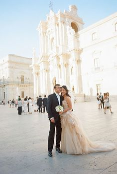 "Pei Pei Chan and Christian Mirabella of Washington, D.C., are an international couple with a passion for travel. So what better way to celebrate than with a romantic destination wedding—in a 12th-century Italian castle, to boot? On June 22, 2012, the couple tied the knot in the groom's small island hometown of Siracusa, Sicily. ""I'm Chinese-American, and he's Italian,"" Pei Pei says. ""We wanted an international wedding, and Sicily is so romantic. We got married at the Cathedral of Siracusa…"